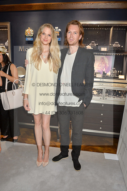 GABRIELLA WILDE and ALAN POWNALL at a party to celebrate the opening of Mappin & Webb's Flagship Regent Street Boutique at 132 Regent Street, London on 28th June 2016.