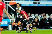 Miguel Almiron (#24) of Newcastle United battles for possession of the ball with James Ward-Prowse (#16) of Southampton during the Premier League match between Newcastle United and Southampton at St. James's Park, Newcastle, England on 8 December 2019.