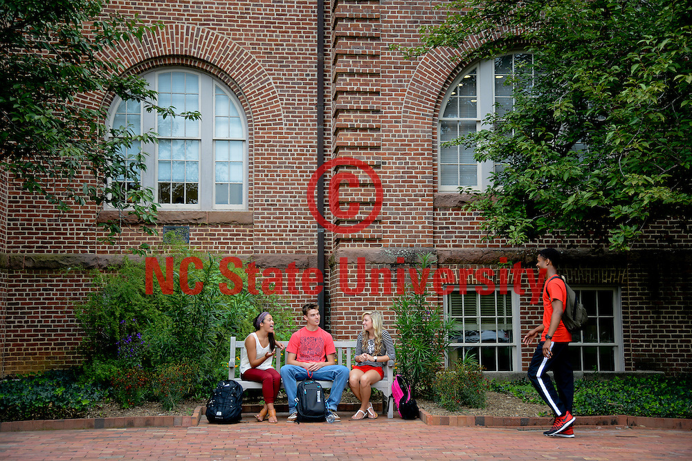 Students chat in front of Holladay Hall on campus. Photo by Marc Hall