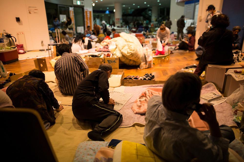 KUMAMOTO, JAPAN - APRIL 19: A man reads newspaper inside the Mashiki Town Gymnasium evacuation center on April 19, 2016 in Mashiki, Kumamoto, Japan. This is their fourth day in the evacuation center since magnitude-6.3 quake hit Kumamoto city.<br /> Photo: Richard Atrero de Guzman
