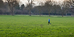 Richmond, London, February 17th 2016. A woman jogs across the fields as dawn breaks over  Richmond. <br /> ///FOR LICENCING CONTACT: paul@pauldaveycreative.co.uk TEL:+44 (0) 7966 016 296 or +44 (0) 20 8969 6875. &copy;2015 Paul R Davey. All rights reserved.