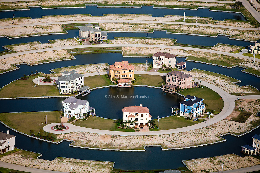 Harborwalk is a planned waterfront community built on wetlands on the western coast of Galveston Bay.  In the coming century this land will be some of the most vulnerable on the Texas coast to sea-level rise, yet developers continue to construct low-lying homes to cash in on waterfront property values.