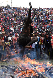 A man of Yi ethnic group jumps over a bonfire to drive out ill fortune during the annual fire worshipping festival, which falls on the third day of the second month in the Chinese lunar calendar at Xiyi Township under Mile City, southwest China's Yunnan Province, March 11, 2016. EXPA Pictures © 2016, PhotoCredit: EXPA/ Photoshot/ Lin Yiguang<br /> <br /> *****ATTENTION - for AUT, SLO, CRO, SRB, BIH, MAZ, SUI only*****