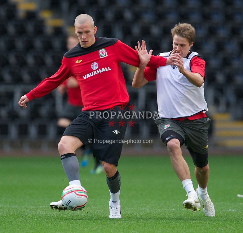 SWANSEA, WALES - Thursday, October 6, 2011: Wales' Steve Morison and David Edwards during a training session ahead of the UEFA Euro 2012 Qualifying Group G match against Switzerland at the  Liberty Stadium. (Pic by David Rawcliffe/Propaganda)
