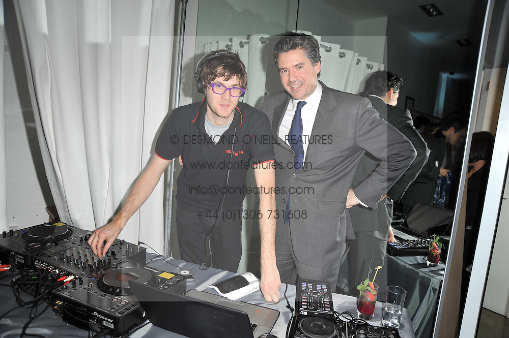 Left to right, ISAAC FERRY and EDWARD TAYLOR at a party to launch pop-up store Oxygen Boutique, 33 Duke of York Square, London SW3 on 8th February 2011.