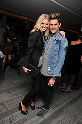 DONNA AIR and HENRY HOLLAND at a dinner in honour of artist Ryan McGinley hosted by Alison Jacques to mark the occasion of his UK debut show 'Moonmilk' held at Paramount, Level 31, Centre Point, 103 New Oxford Street, London WC1 on 10th September 2009.