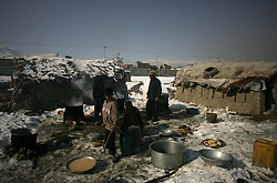 Afghan refugee men make food for their guest inside a refugee camp in Kabul, Afghanistan, January 2, 2013. Photo by Imago / i-Images...UK ONLY