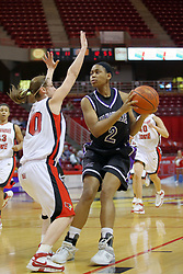 08 March 2008: Anaris Sickles pulls back the ball to keep it from Kristi Cirone. The University of Evansville Purple Aces and the Illinois State University Redbirds took the court looking for the MVC season title, but the Redbird win (87-72) split the title.  The game was played on Doug Collins Court in Redbird Arena in Normal Illinois.