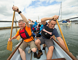 Pictured: To show their support for the Port Edgar Dragons, a dragon boat team for cancer survivors, Scottish Liberal Democrat leader Willie Rennie and Alex Cole-Hamilton MSP paddlied out the Port Edgar Marina, South Queensferry.<br /> <br /> Saturday 2nd September, 2017.<br /> <br /> Port Edgar Marina, South Queensferry<br /> <br /> <br /> <br /> Michael Schofield