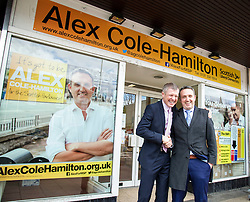 Pictured: Willie Rennie and Alex Cole-Hamilton outside the Lib Dem shop in Corstorphine.<br /> <br /> Liberal Democrat leader Willie Rennie was in campaign mode when in Edinburgh Western ahead of the second TV leaders' debate. Mr Rennie joined volunteers at a street stand outside the local campaign office in Corstorphine with local candidate Alex Cole-Hamilton. <br /> <br /> Ger Harley | EEm 29 March 2016