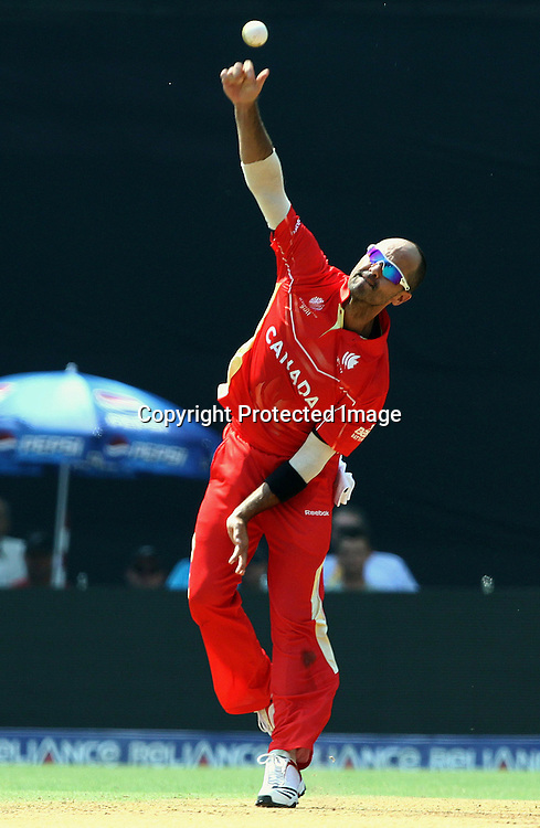 Canada bowler John Davison in action against New Zealand During the ICC Wolrd Cup-2011 Canada vs New Zealand match Played at Wankhede Stadium, Mumbai,