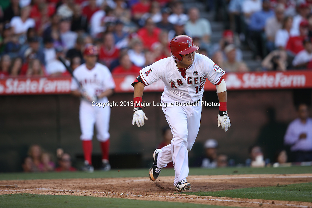 ANAHEIM, CA - JUNE 15:  Hank Conger #16 of the Los Angeles Angels of Anaheim runs to first base during the game against the New York Yankees on Saturday, June 15, 2013 at Angel Stadium in Anaheim, California. The Angels won the game 6-2. (Photo by Paul Spinelli/MLB Photos via Getty Images) *** Local Caption *** Hank Conger