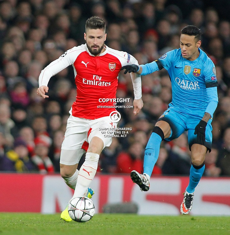 LONDON, ENGLAND - FEBRUARY 23: Olivier Giroud of Arsenal and Neymar of Barcelona compete for the ball during the Champions League match between Arsenal and Barcelona at The Emirates Stadium on February 23, 2016 in London, United Kingdom. (Photo by Mitchell Gunn/ESPA-Images)