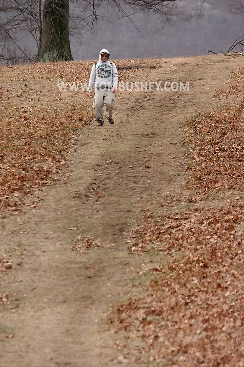 Mountainville, N.Y. - A man walks back to the trail head after hiking on Schunnemunk Mountain on Feb. 25, 2006.