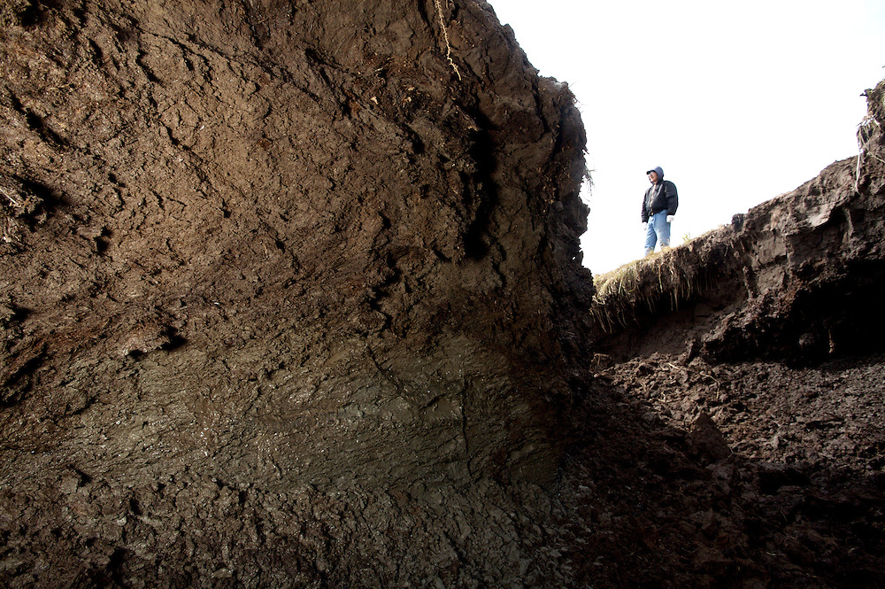 Land erosion showing menting permafrost in Newtok, Alaska. 2008