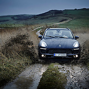 Porsche Macan on a dirt track with green hills in the background and mud splashing Ray Massey is an established, award winning, UK professional  photographer, shooting creative advertising and editorial images from his stunning studio in a converted church in Camden Town, London NW1. Ray Massey specialises in drinks and liquids, still life and hands, product, gymnastics, special effects (sfx) and location photography. He is particularly known for dynamic high speed action shots of pours, bubbles, splashes and explosions in beers, champagnes, sodas, cocktails and beverages of all descriptions, as well as perfumes, paint, ink, water – even ice! Ray Massey works throughout the world with advertising agencies, designers, design groups, PR companies and directly with clients. He regularly manages the entire creative process, including post-production composition, manipulation and retouching, working with his team of retouchers to produce final images ready for publication.