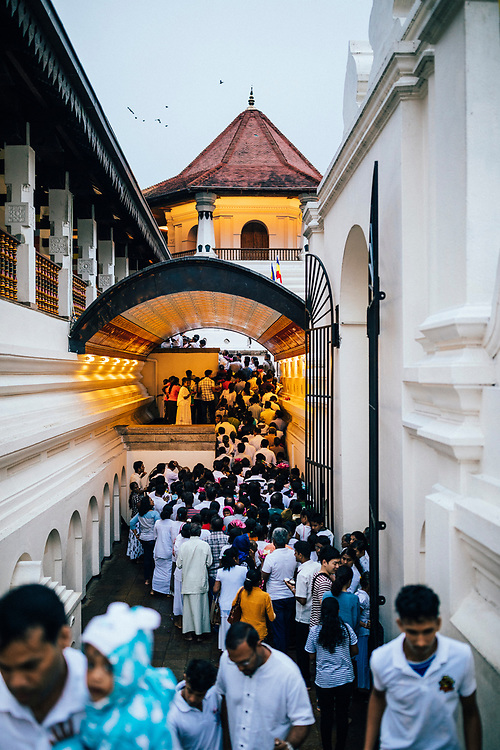 Kandy, Sri Lanka -- January 31, 2018: Crowds travel to the Temple of the Tooth on Poya Day.