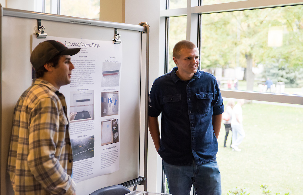 Students present their research projects to friends, families, and professors during Gonzaga University's Fall Family Weekend in the Hughes Hall on October 9th, 2016. (Photo by Edward Bell)