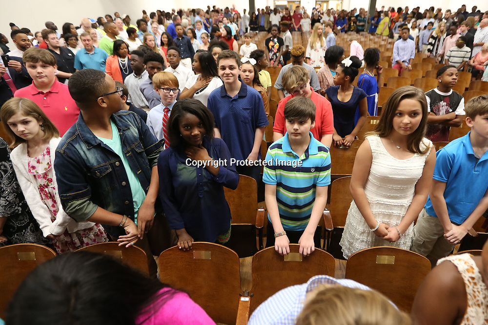Milam students stand after entering the auditorium prior to the start to the school's promotion day where they received awards for their achievements from the school year. Promotion day celebrates the students moving on to the middle school.