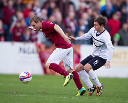 Linlithgow Rose Blair Batchelor and Raith Rovers Kevin Moon.<br /> Linlithgow Rose 0 v 2 Raith Rovers, William Hill Scottish Cup Third Round game player today at Prestonfield.