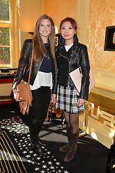 Left to right, KATE SWAIN and ATHENA MIN at a lunch to view Solange Azagury-Partridge's new collection - Chromance at her store at 5 Carlos Place, London on 7th October 2014.