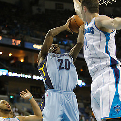 April 15, 2012; New Orleans, LA, USA; Memphis Grizzlies small forward Quincy Pondexter (20) shoots over New Orleans Hornets power forward Jason Smith (14) and shooting guard Eric Gordon (10) during the second half of a game at the New Orleans Arena. The Hornets defeated the Grizzlies 88-75.  Mandatory Credit: Derick E. Hingle-US PRESSWIRE