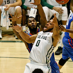 Jan 17, 2016; New Orleans, LA, USA; Tulane Green Wave guard Louis Dabney (0) shoots over Southern Methodist Mustangs forward Markus Kennedy (5) during the second half of a game at the Devlin Fieldhouse. Southern Methodist defeated Tulane 60-45. Mandatory Credit: Derick E. Hingle-USA TODAY Sports