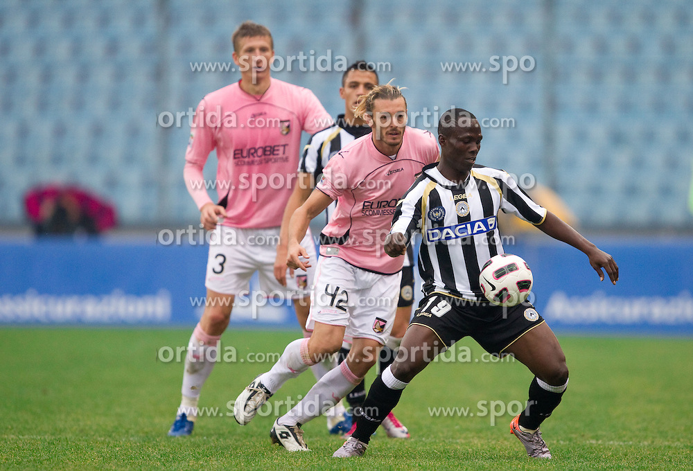 Federico Balzaretti of Palermo vs Badu Emmanuel Agyemang of Udinese during football match between Udinese Calcio and Palermo in 8th Round of Italian Seria A league, on October 24, 2010 at Stadium Friuli, Udine, Italy.  Udinese defeated Palermo 2 - 1. (Photo By Vid Ponikvar / Sportida.com)