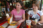"(MODEL RELEASED IMAGE). Marzena Sobczynska worries that her 13-year-old daughter Klaudia (pictured with friend Ola) doesn't appreciate the foods that are available to her. ""She lives at a different time than I did,"" says Marzena, who grew up when food was difficult to get during Poland's communist rule. (Supporting image from the project Hungry Planet: What the World Eats.) The Sobczynscy family of Konstancin-Jeziorna, Poland, is one of the thirty families featured, with a weeks' worth of food, in the book Hungry Planet: What the World Eats."