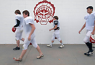 11/7/07 Smith Center, KS.L-R Taylor Rippe, Spenser VanderGeisen, Colt Rogers, Brit Nixon  of the Smith Center High School football team heads to practice...(Chris Machian/Prairie Pixel Group)