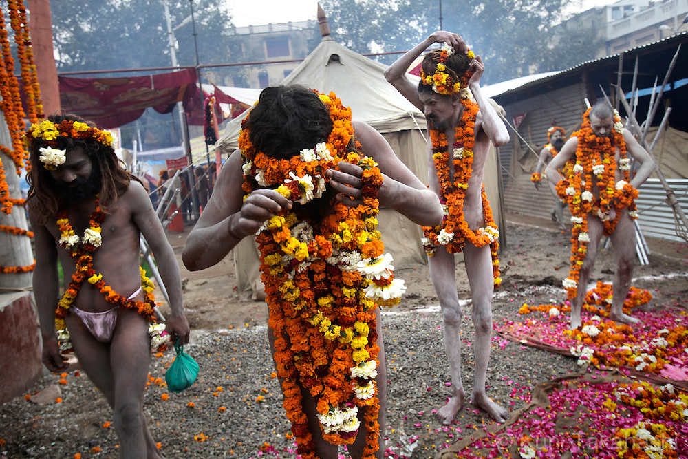 Sadhus (holy men) wear flowers in Haridwar, India on Feb 2010 during Kumb Mela, largest Hindu gathering in the world. Hindus believe that bathing in the Ganges during the festival cleanses them of sin. Photo by Kuni Takahashi