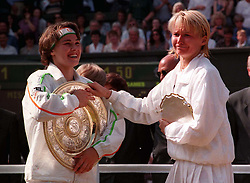 File photo dated 05-07-1997 of Jana Novotna attempting to steal the Challenge trophy from Martina Hingis on Centre Court after the Ladies Singles Final at Wimbledon.
