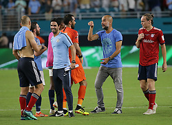July 28, 2018 - Miami Gardens, FL, USA - Manchester City head coach Josep Guardiola celebrates with goalkeeper Claudio Bravo and other players after a 3-0 victory against the Bayern Munich in an International Champions Cup match at Hard Rock Stadium in Miami Gardens, Fla., on Saturday, July 28, 2018. (Credit Image: © Pedro Portal/TNS via ZUMA Wire)