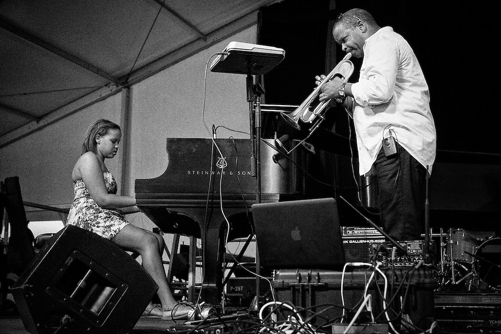 Jazz musician Terence Blanchard performing with his daughter, Sidney Bechet Blanchard on stage in the Jazz Tent at the 2011 New Orleans Jazz & Heritage Festival at the Fair Grounds Race Course in New Orleans, Louisiana. USA.