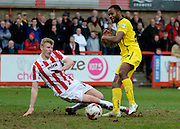Goalscorer Zak Ansah has shot blocked during the Sky Bet League 2 match between Cheltenham Town and Plymouth Argyle at Whaddon Road, Cheltenham, England on 28 March 2015. Photo by Alan Franklin.