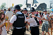 Police chatting with and instructing festival goers, Glastonbury Festival June 2010