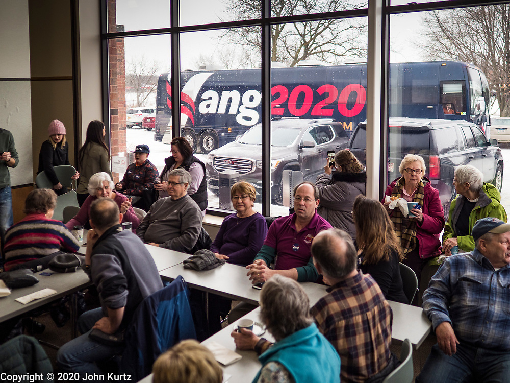 22 JANUARY 2020 - CHARLES CITY, IOWA: Andrew Yang's campaign bus arrives at the public library in Charles City, IA. Yang, an entrepreneur, is running for the Democratic nomination for the US Presidency in 2020. He is in northern Iowa as a part of his 17 day bus tour across the state. Iowa hosts the the first election event of the presidential election cycle. The Iowa Caucuses will be on Feb. 3, 2020.      PHOTO BY JACK KURTZ