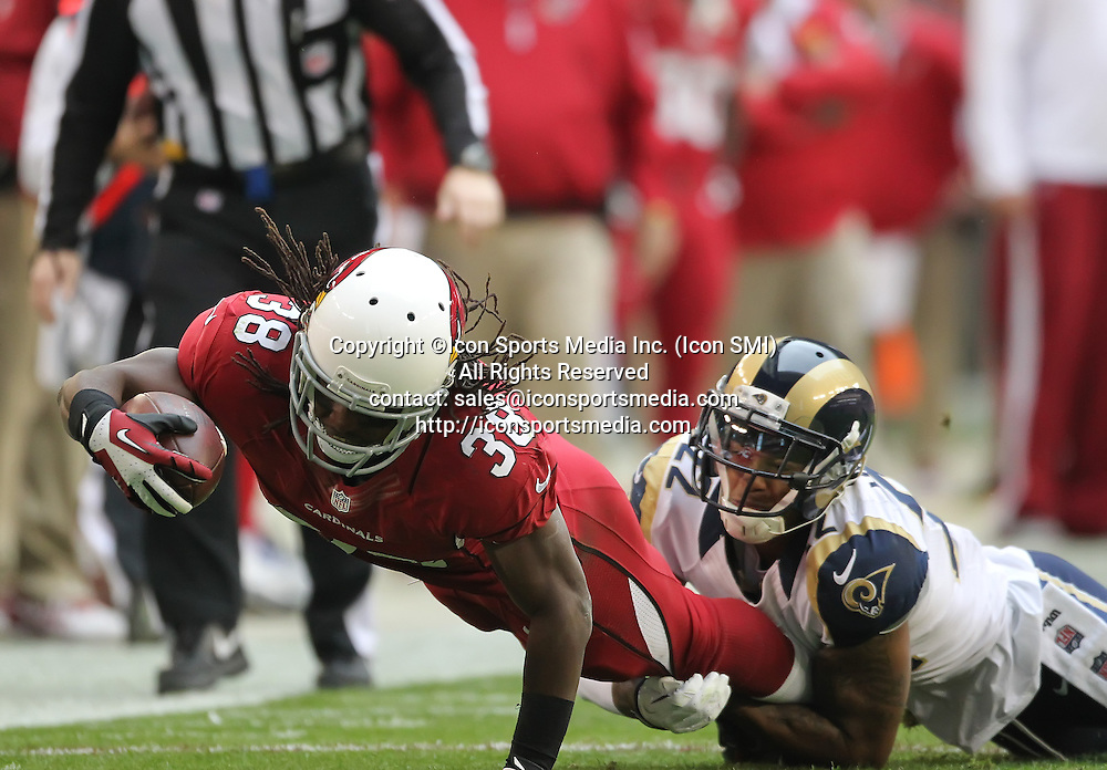 Dec 8 2013: Cardinals RB Andre Ellington (38) lunges with the football during the Arizona Cardinals hosting the St. Louis Rams game in the University of Phoenix Stadium in Glendale, AZ.  The Cardinals defeat the Rams 30-10.
