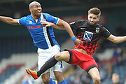Calvin Andrew is challenged by Chris Stokes during the EFL Sky Bet League 1 match between Rochdale and Coventry City at Spotland, Rochdale, England on 17 April 2017. Photo by Daniel Youngs.