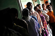 Voters line up to cast their ballot a polling station during the second phase of voting in parliamentary elections April 23, 2009 in the Muslim dominated town of Mukalmua in the state of Assam, India. Polling took place amid tight security after several acts of militant violence in recent days.