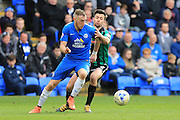Marcus Maddison, Joe Rafferty during the Sky Bet League 1 match between Peterborough United and Rochdale at London Road, Peterborough, England on 9 April 2016. Photo by Daniel Youngs.