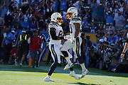 Sep 8, 2019; Carson, CA, USA; Los Angeles Chargers running back Austin Ekeler (30) celebrates with tight end Virgil Green (88)after scoring on a 7-yard touchdown run in overtime against the Indianapolis Colts at Dignity Health Sports Park. The Chargers defeated the Colts 30-24 in overtime.