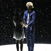 Olympic Gold medalists Meryl Davis and Charlie White perform during the opening song at the Stars on Ice Figure Skating tour stop at the Amway Center on Sunday, April 6, 2014 in Orlando, Florida. (AP Photo/Alex Menendez)