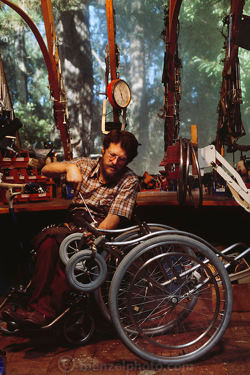 Inventor and Macarthur foundation winner Ralph Hotchkiss in his Oakland, California, workshop designing wheelchairs. Hotchkiss is himself confined to a wheelchair. MODEL RELEASED. USA.