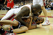 Apr 27, 2010; Cleveland, OH, USA; Chicago Bulls center Joakim Noah (13) grimaces as Cleveland Cavaliers center Shaquille O'Neal (33) attempts to gain possession of the ball during the third period in game five in the first round of the 2010 NBA playoffs at Quicken Loans Arena.  Mandatory Credit: Jason Miller-US PRESSWIRE