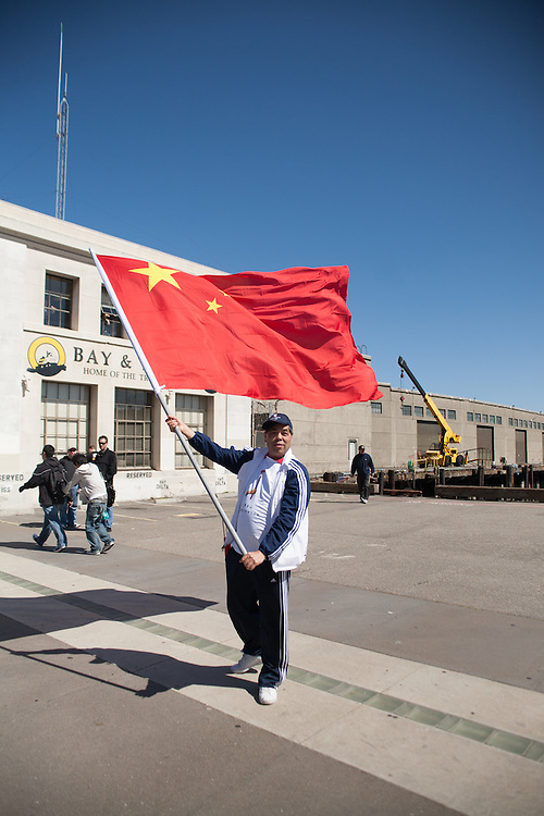Man waves Chinese flag during San Francisco Olympic Torch Relay