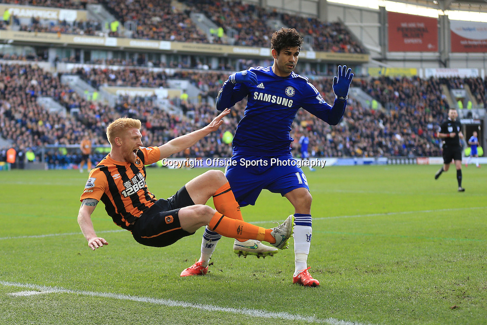 22 March 2015 - Barclays Premier League - Hull City v Chelsea - Paul McShane of Hull City reacts to a challenge from Diego Costa of Chelsea - Photo: Marc Atkins / Offside.