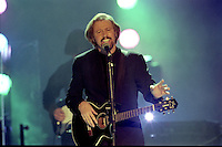 BARRY GIBB - BEE GEES<br />Outstanding Contribution winners (1997)<br />The Bee Gees took to the stage to belt out a medley of some of the band's biggest hits, including To Love Somebody, Massachusetts, Words, How Deep Is Your Love, Jive Talkin', Stayin' Alive and You Should Be Dancing. The audience took the lyrics of the last song to heart and by the end of their set 13,000 people were on their feet (or on tables) throwing their arms in the air and singing along. It was one of pop's most uplifting moments.<br /> 24 Feb, 1997 (Photo John Marshall/JM Enternational)