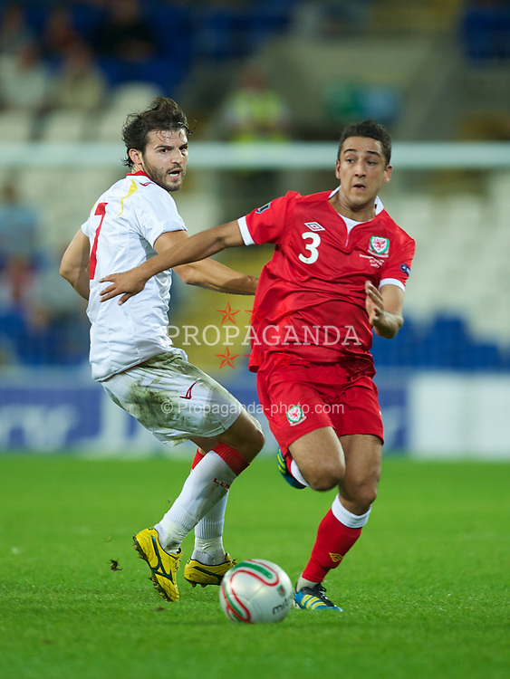CARDIFF, WALES - Friday, September 2, 2011: Wales' Neil Taylor in action against Montenegro's Simon Vukcevic during the UEFA Euro 2012 Qualifying Group G match at the  Cardiff City Stadium. (Pic by David Rawcliffe/Propaganda)