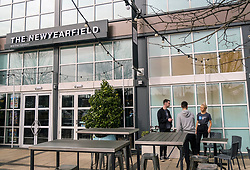 "Livingston During Coronavirus Outbreak, 21 March 2020<br /> <br /> Cafes, pubs and restaurants have been ordered to close, to tackle coronavirus. Nightclubs, theatres, cinemas, gyms and leisure centres must do so ""as soon as they reasonably can"", the government said.<br /> <br /> These steps are part of the UK's social distancing measures.<br /> <br /> Everybody is being asked to avoid non-essential contact with other people.<br /> <br /> Pictured: Weatherspoon's ""The Newyearfield"" pub in Livingston ignored the government's advice to close. Staff are seen breaking social distancing advice by having a cigarette break together<br /> <br /> Alex Todd 